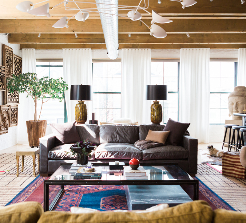 This Millennial Loft Designed By Michael Has Multiple Wow Factors The Bright Rug Wall Decor And Statement Sculpture In Corner